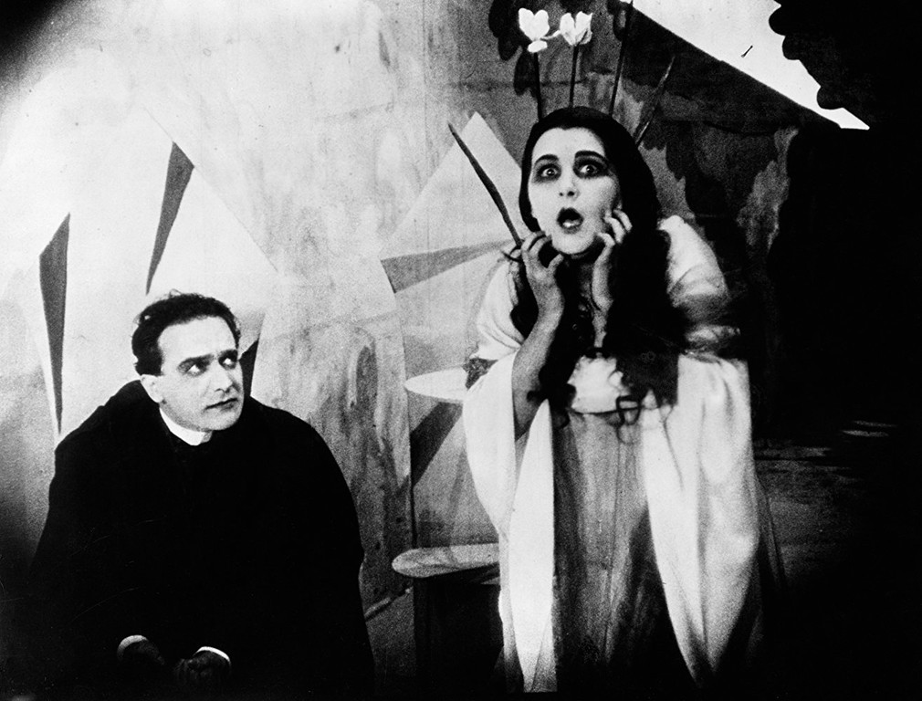 Two stills from the cabinet of dr caligari showing (left) the.